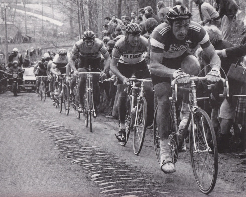 1980Moser leads eventual winner Michel Pollentier, followed by Marc De Meyer and Jan Raas. Moser looks like the Hulk compared to Pollentier